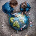 little girls chalk drawing earth planet