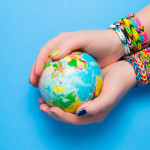young girl hands earth