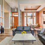 stylish modern living room coffee table flowers wood floors