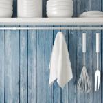 kitchen storage shelves plates hanging utensils