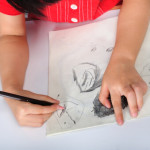 child hands drawing