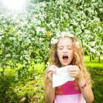 sneezing girl under trees