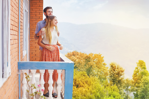 couple on balcony in summer