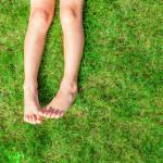 kid legs feet backyard lawn