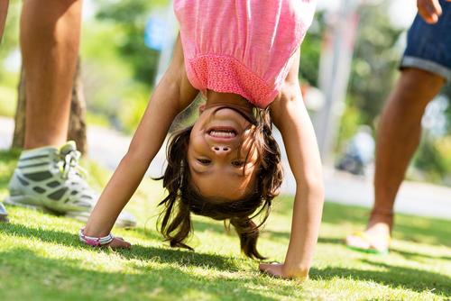 little girl handstand backyard