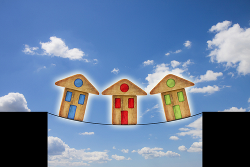 houses on tightrope illustration