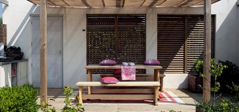 Mediterranean style deck and backyard