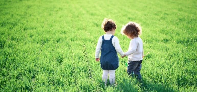 two children green field