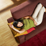 comfortable living room bamboo floors woman on sofa