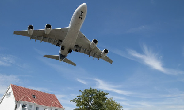 airplane over house