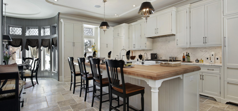 kitchen island wood counter stone tile floors