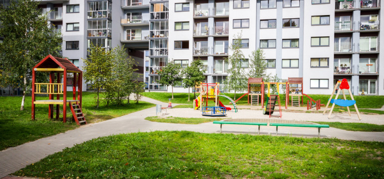 apartment building with playground
