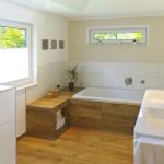 wood floor in bathroom with tub