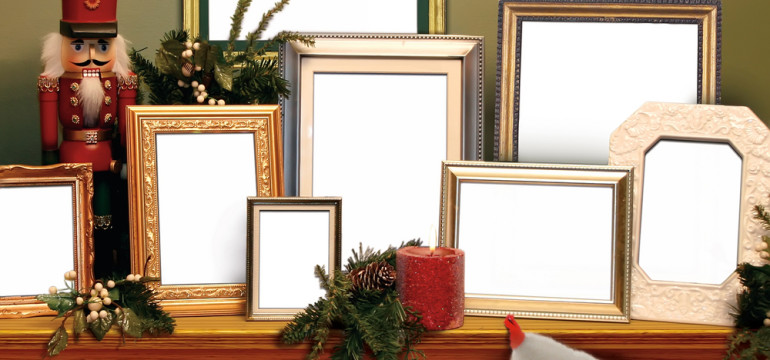 christmas mantel with photoframes toy solidier
