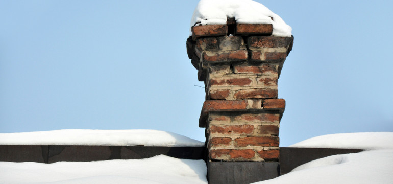 snow on the roof brick chimney