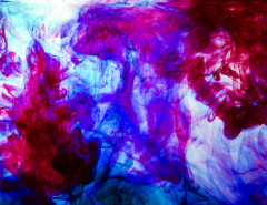 blue purple red ink swirls in water