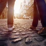 walking city tourists pavement cobblestone