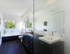 modern bathroom dark tile