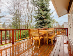 wood deck in the rain with wood patio furniture