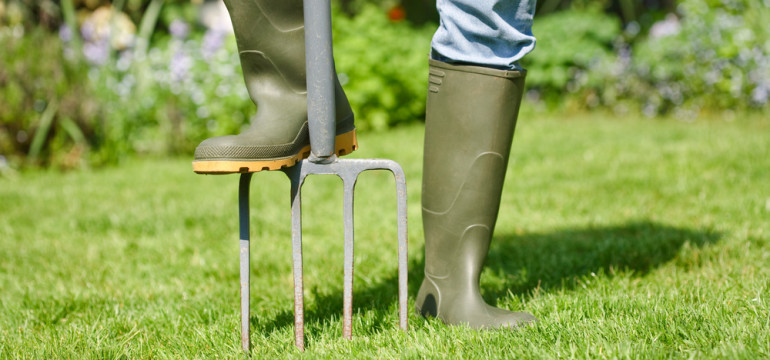 backyard mainteance rubber boots pitchfork