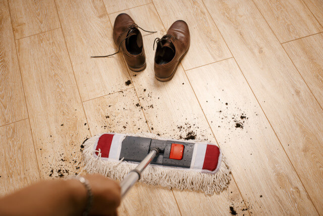 mopping dirty laminate