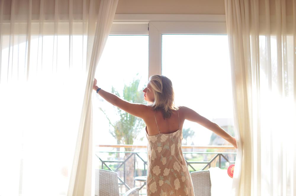 Open window woman fresh air