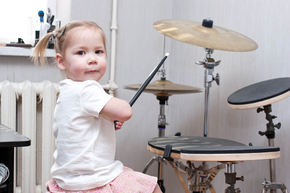 Child Playing Drums