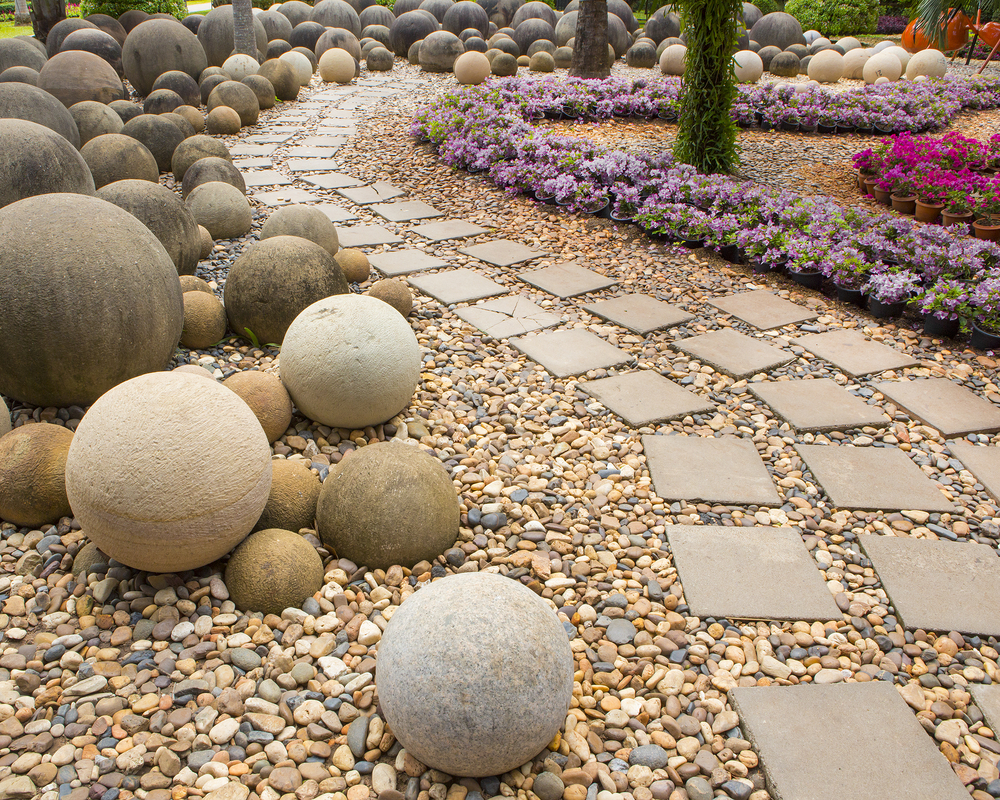 11 simple outdoor living design tips to add backyard spark for Garden idea with stones