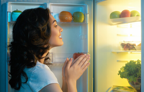 woman open fridge