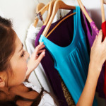 woman sorting through her wardrobe