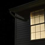 house exterior at night lit window stars