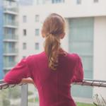 woman on apartment balcony