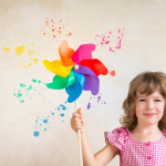 little girl with color wheel pinwheel