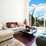 tasteful furniture placement living room natural light