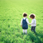 two children green field