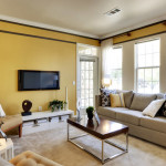 bright living room yellow accent wall