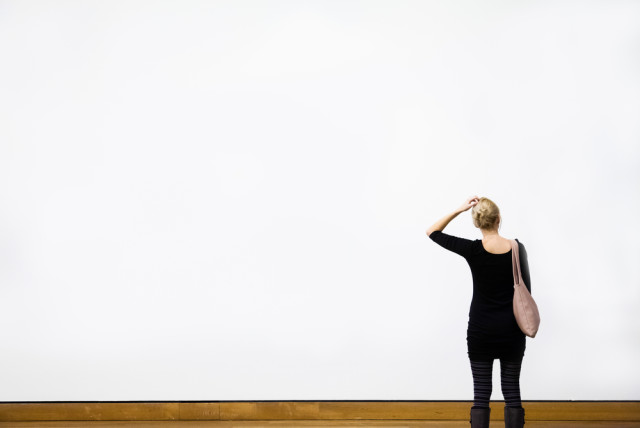 blank wall woman wondering
