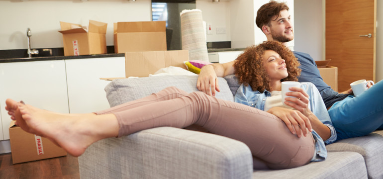 couple moved into a new home on couch