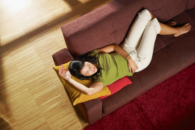 comfortable living room bamboo floors woman on sofa
