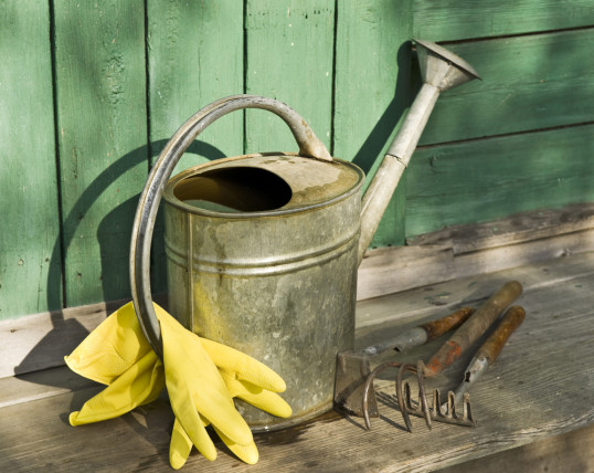 fall garden watering can gloves spade