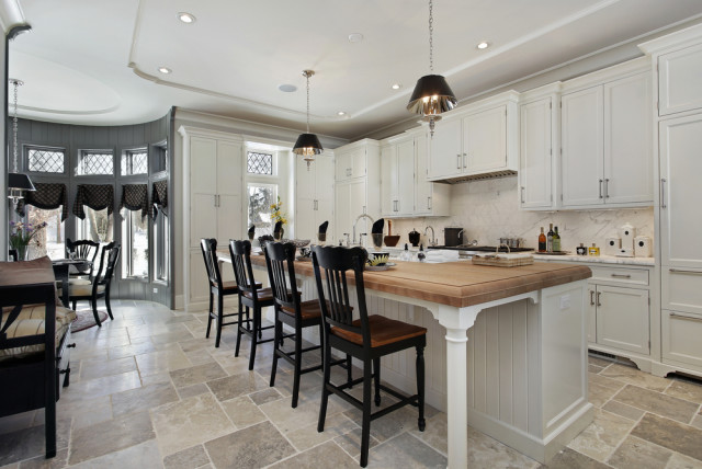 kitchen island wood counter stone tile floors
