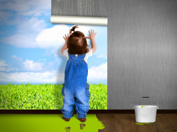 child hanging wall paper