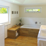 wood floor in bathroom with tub