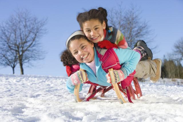 winter sledding little girls
