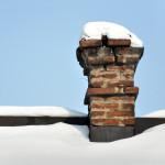 snow on the roof brick chimney