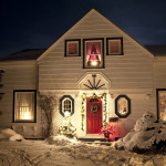 winter home exterior red front door