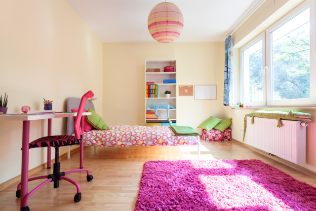 bright kids bedroom throw rug wood flooring