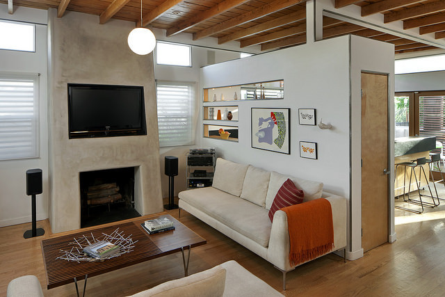 modern living room wood flooring off white couch
