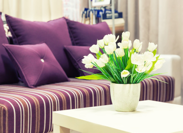 living room sofa purple cushions flowers vase