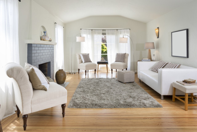 white living room grey fireplace wood flooring